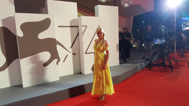 Silvia Busacca walks the Red Carpet during the 74th Venice International Film Festival, wearing a yellow dress made by Marciano Los Angeles– Ph Credit Silvia Busacca ©